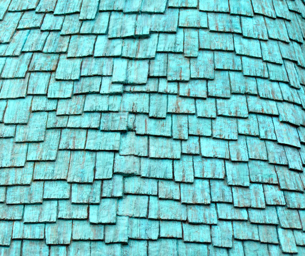 green slats: abstract image of green wooden roof tiling slats