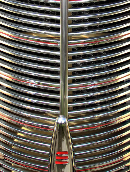 silver & red round grille1: old vintage vehicle radiator grille