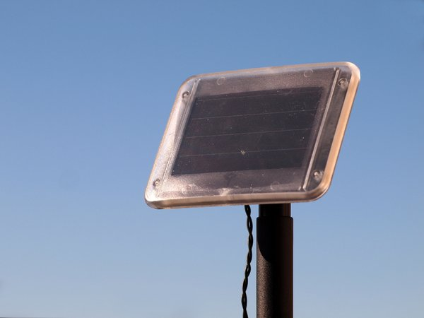 Solar Power: Small solar power cells in sunlight with blue sky in the background