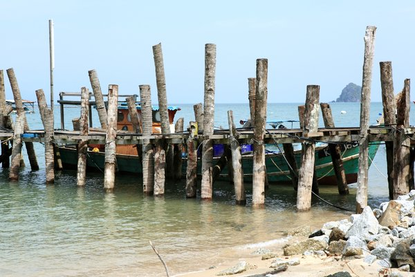 Fishing Boat Scene: Fishing boat by a wooden jetty