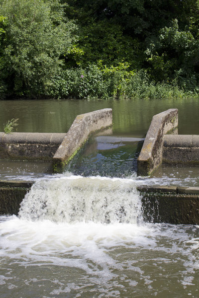 Water aeration: A miniature weir to aerate river water in Sussex, England.
