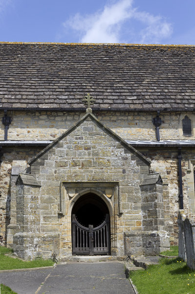 Church entrance: A side entrance to a church in East Sussex, England.