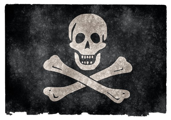 Jolly Roger Grunge Flag: Grunge textured Jolly Roger pirate flag on vintage paper. You can find hundreds of grunge flags on my website www.freestock.ca in the Flags & Maps category, I'm just posting a sample here because I do not want to spam rgbstock ;-p