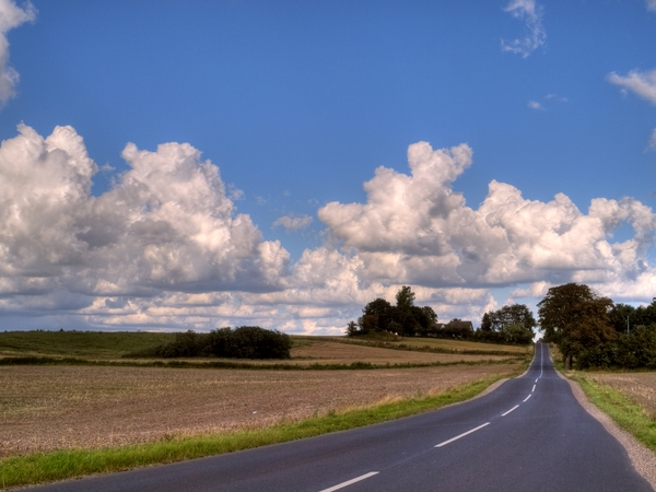 Country road - HDR: Rural landscape with a narrow road. The image is HDR.
