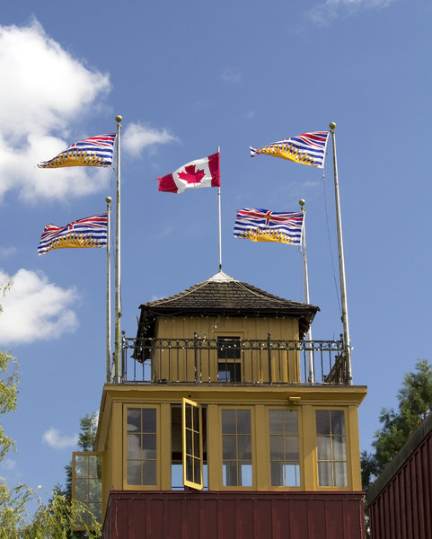 Canada flags: Canadian national and provincial (British Columbia) flags on top of an old building in Canada.