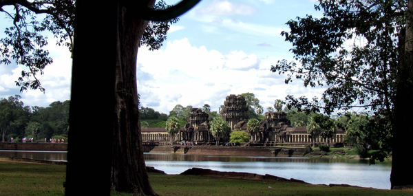 Angkor approach7: entrance way to Angkor temple complex seen from across surrounding moat/lake