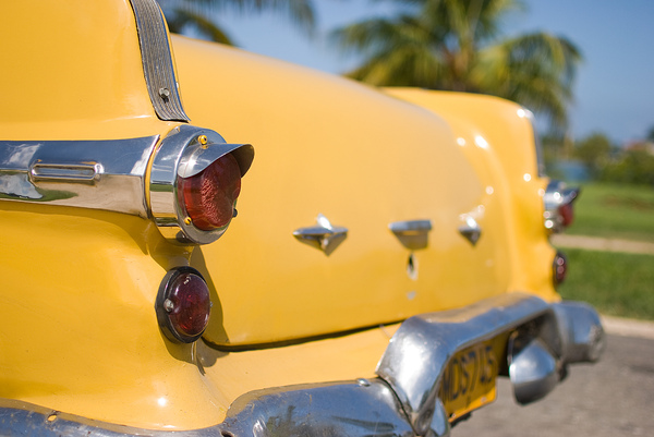 Yellow Cuban classic car: Backside of a Cuban classic car