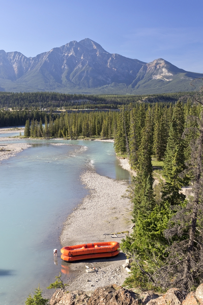 Beached river raft: An inflatable raft beached after floating downriver in western Canada.
