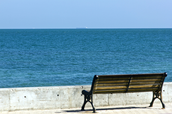Waiting for Ship: Bench along Seawall, where one could wait for their ship to come in....