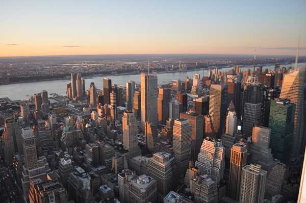 View from the Empire State: Evening light over the Manhattan skyline.