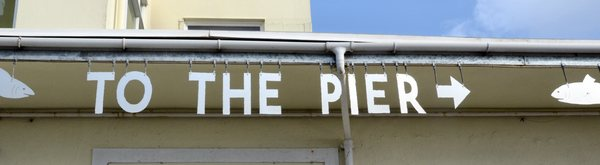 to the pier: Sign on pier