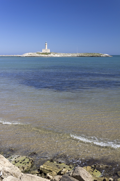 Lighthouse bay: A lighthouse in a bay in Puglia, southern Italy.