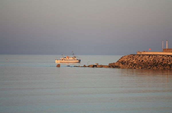 Pleasure boat: Pleasure cruise boat off shore on still summer evening