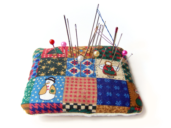 A Little Pincushion: Pincushion made out of scrap Xmas fabric with pins and needles.  Amazing what you notice in photos, I found out there was a broken rusty needle that I needed to throw out!