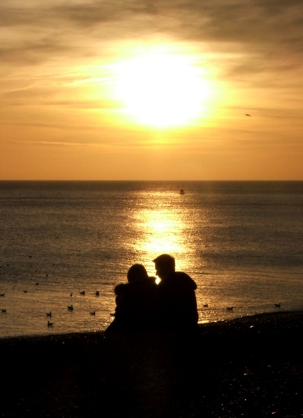 Beach Romance: Couple having a romantic moment on the beach