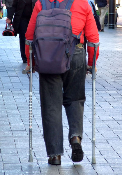 on crutches1: man with aluminium adjustable mobility aids