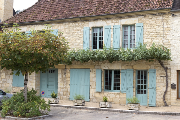 House shutters: Shuttered windows and doors on an old restored house in the Dordogne, France.