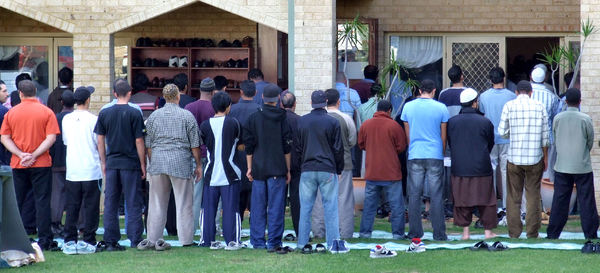 gathering for prayers2: Muslim men gathering for Friday prayer at mosque - outside overflow