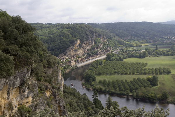 River cliffs and village