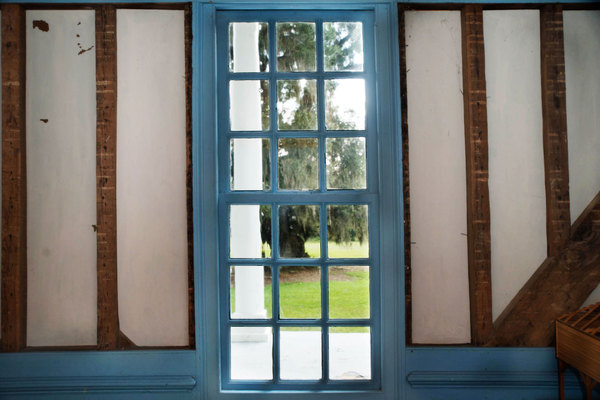 1730 Window: Window constructed in 1730 in an American plantation house, looking out to porch