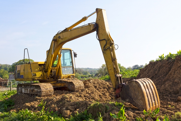 Mechanical excavator: A mechanical digger on a farm in England.