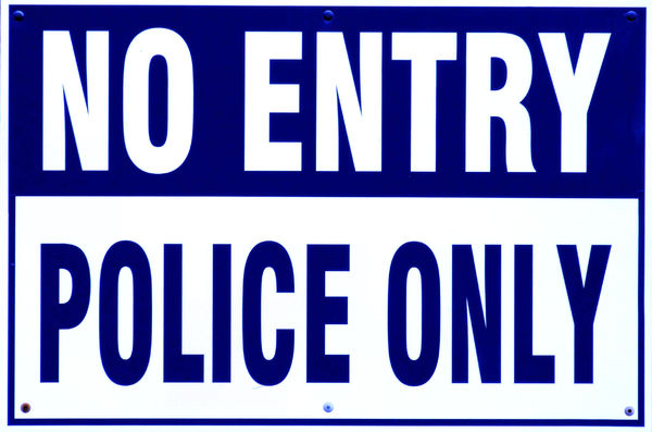 limited entry1: entrance sign to police compound