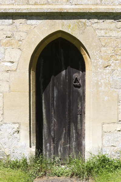 Old door: An old door in a side wall of a church in Gloucestershire, England.