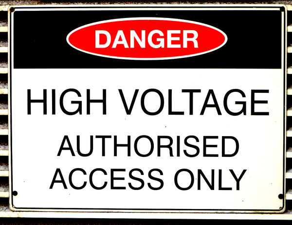 high powered warning1: warning sign on electricity power supply building