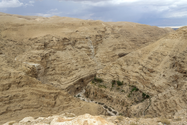Israel desert gorge: A gorge in the Judean desert, Israel, with a rare rainstorm approaching.