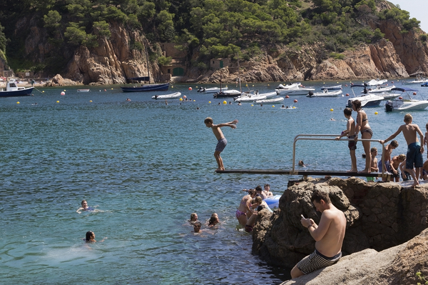 Diving board: A diving board in a cove on the Costa Brava, Spain.