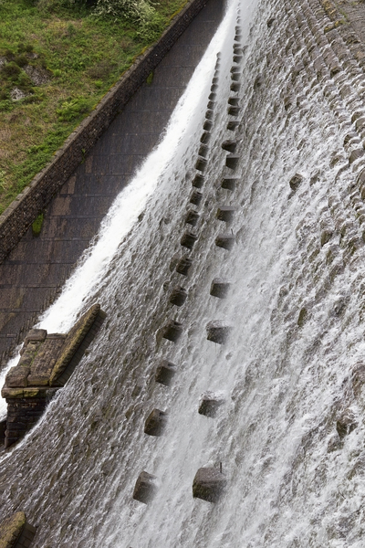 Dam cascade: Water cascading down the wall of an old dam in the Elan Valley, Wales.