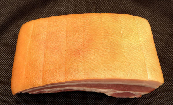 pork belly - speck9: scored-cut slab of smoked pork belly