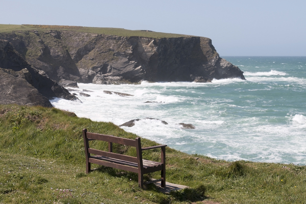 Seat by the sea: A seat on the coast of Cornwall, England.