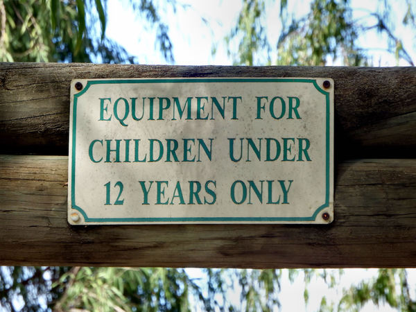 kids fun only: sign limiting playground equipment usage