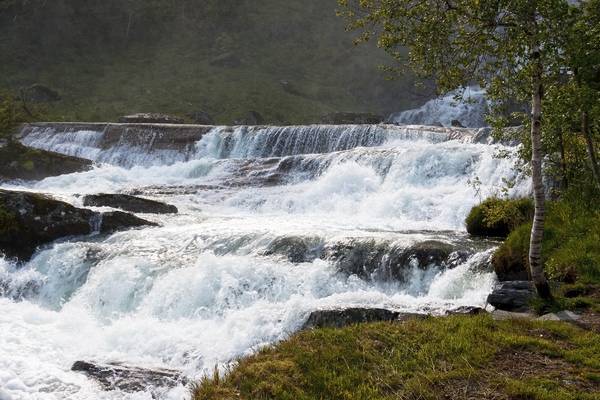 Raging water: Outflow from the base of the Tvindefosse waterfall, Norway.