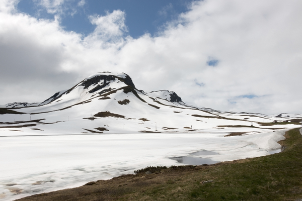 Snowy mountains: Snowy mountains on a high plateau in Norway in July, with the beginnings of snow melt.