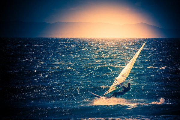 Wind Surfer: Wind surfing at the beach on a sunny winter's afternoon Byron Bay northern NSW Australia