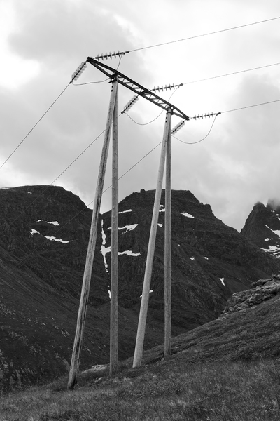 Electricity supply (B/W): Electricity supply over mountains in the Lofoten Islands, Norway.