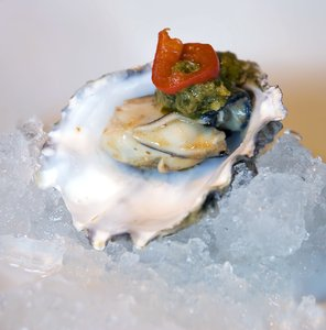 Oyster 2: A raw oyster with some sauceNB: Credit to read