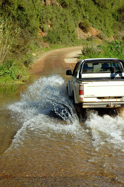 Crossing over: A bakkie (or pickup) crossing a drift.NB: Credit to read