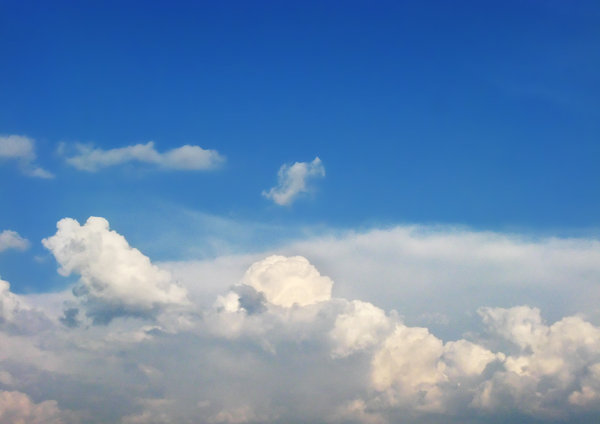 Fluffy Clouds: White fluffy clouds on blue sky