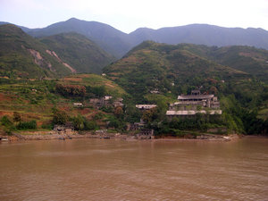 Before: Houses that will disappear because of the rise of the water level in the Yangtze river due to the Three Gorges Dam. In 2006 some of these houses might still be standing but in 2009 at the completion of the dam they will be under water.