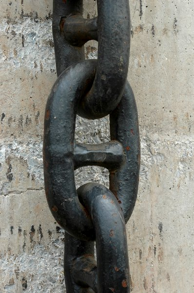 anchor chain: an anchor chain hanging off a wall.