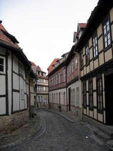 old and winding rural lane: An old and winding rural lane in Quedlinburg, Germany. There are lots of half-timbered houses in this beautiful old city.