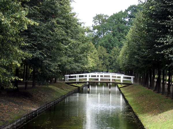 bridge over a channel: lovely architecture - a bridge over a channel for a nice walk in a park