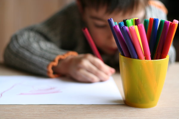 colour: little child making a drawing