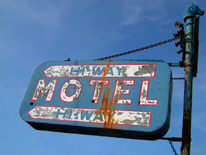 Lonely Hi-Way: Old run down hotel, could be right out of the story 'Psycho'. The rust on the sign looks kind of like horror movie blood?? Oooo ... scary! Ha, ha!! :-) Or it's more like just a nice piece of friendly roadside history.