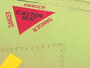 Eject!: This sign was on the side of an old jet fighter.