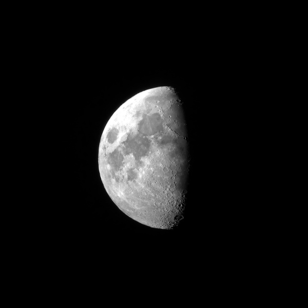 Moon (Luna): Half moon from as seen from a small telescope.