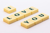 Words: Love: A simple picture of letters forming the word 'love' and some variations around this